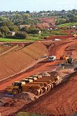 stock photo of dump  - dump trucks on a road construction site - JPG