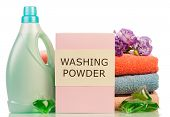 stock photo of detergent  - Detergent with washing powder and towels isolated on white - JPG