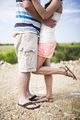image of legs air  - a couple kissing with her leg in the air - JPG