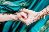 picture of mehendi  - Indian hindu bride with mehendi heena on hand - JPG