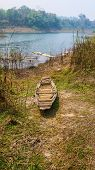 picture of old boat  - Old boat wooden brown in  the reservoir - JPG