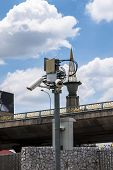 stock photo of cctv  - Security cctv camera in front of blue sky - JPG