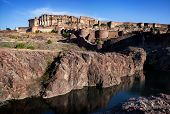 stock photo of rajasthani  - Mehrangarh fort on the hill at blue sky in Jodhpur Rajasthan India - JPG