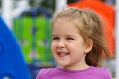 stock photo of little young child children girl toddler  - Portrait a little girl on playground - JPG
