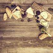 stock photo of french culture  - French snacks on a wooden table with space for text - JPG