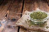 foto of mung beans  - Dried Mung Beans (detailed close-up shot) on vintage wooden background