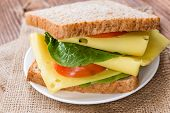 stock photo of sandwich  - Fresh made Cheese Sandwich on an old rustic wooden table - JPG