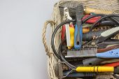 stock photo of grooming  - Used tools and supplies for a dog grooming are in knitted basket - JPG