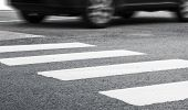 pic of pedestrian crossing  - Pedestrian crossing road marking and fast moving car photo with selective focus and shallow DOF - JPG