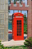 image of phone-booth  - Red phone booth in a city park - JPG