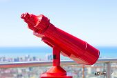 foto of binoculars  - A high power red binoculars for overlook - JPG