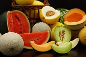pic of honeydew melon  - Fresh melons on a dark wooden table - JPG