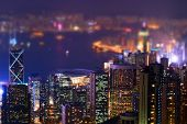 picture of tilt  - Night aerial view panorama of Hong Kong skyline and Victoria Harbor - JPG