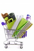 foto of trolley  - close up of the shopping trolley with various fabric materials - JPG
