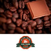image of trade  - Fair Trade graphic against piece of chocolate and coffee seeds together - JPG