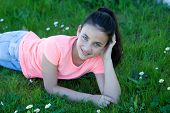 picture of  preteen girls  - Happy casual preteen girl lying in the grass - JPG