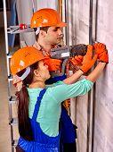 stock photo of millwright  - Happy family in builder helmet indoor - JPG
