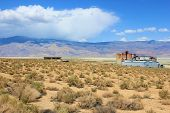 pic of salt mine  - Owens dry lake with a salt mining plant taken in the Owens Valley - JPG