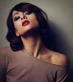 stock photo of blouse  - Sexy posing woman in blouse with short hair style on dark background - JPG