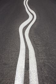 pic of long winding road  - Curved long asphalt road , drunk driving ** Note: Shallow depth of field - JPG