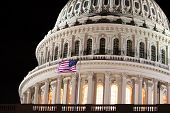stock photo of capitol building  - closeup of united states capitol building with american flag  - JPG