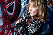 foto of deprivation  - child in front of graffiti wall in urban area - JPG