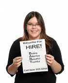 stock photo of babysitter  - A babysitter holding a paper flyer advertising her skills as a babysitter isolated against a white background - JPG