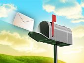 pic of mailbox  - Traditional mailbox and letter over a gorgeous landscape with rolling hills and clouds - JPG