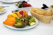 Постер, плакат: Dish of fruit Kiwi and sliced oranges on a platter