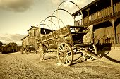 stock photo of wild west  - Wild west Cowboy town with wagon in foreground - JPG