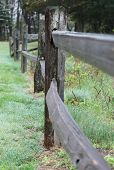 picture of split rail fence  - A close up shot looking down a wooden split rail fence. ** Note: Shallow depth of field - JPG