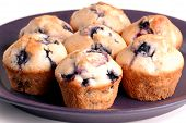 Several Blueberry Muffins On Purple Plate