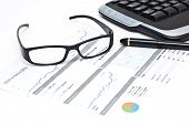 Glasses And Pen On A Printed Web Analytics Report