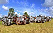 Постер, плакат: Lineup of old threshing machines