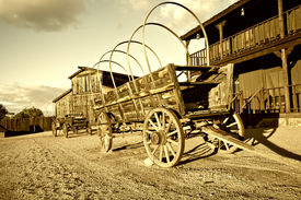 picture of wild west  - Wild west Cowboy town with wagon in foreground - JPG