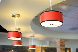 stock photo of light fixture  - Arrangement of hanging light fixtures in a building interior - JPG