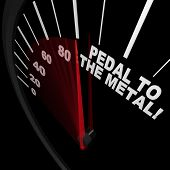 A speedometer with red needle pointing to the words Pedal to the Medal, illustrating the speed achie