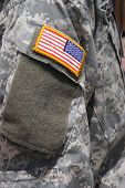 image of usa flag  - Vertical Image of a Flag Patch on Iraq War Soldier Uniform - JPG