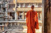 Buddhist Monk Looking At Courtyard Of Angkor Wat, Cambodia poster