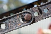 Abstract Textures And Shapes: Aging Metal Chain Plates And Bolts poster
