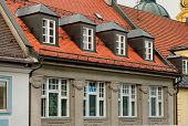 Red Tile Roof And Gabled Dormer Windows In Munich, Germany