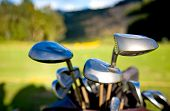 image of golf bag  - golf clubs close up in a golf course - JPG