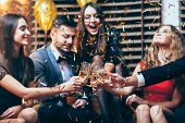 Cheers! Group Of Friends Clinking Glasses Of Champagne During Party Celebration poster