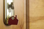 Symbol of the house and stick the key in the keyhole  poster