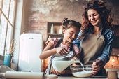 Mom With Daughter On Kitchen. poster