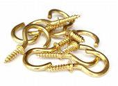 Close up of golden screw hooks