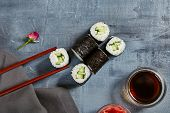 Japanese Sushi - Kappa Maki Sushi Roll (Sushi with Cucumber inside) with Soy Sauce and Ginger over S poster