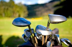 foto of golf bag  - golf clubs close up in a golf course - JPG