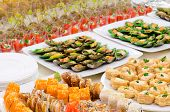stock photo of girdles  - a lot of cold snacks on buffet table catering - JPG