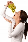 Attractive Young Woman With White Grape Un Her Hand
